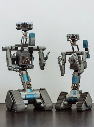 "Miniature Johnny Five prop from ""Short Circuit 2"" & Robot V. The latter was designed by Mike Van Plew & produced by Joz Robotics."